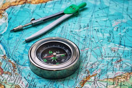 outdated compass sailor on a topographic map
