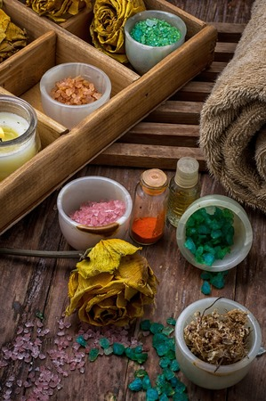 sea aromatic salt for Spa treatments on the background of yellow rose buds