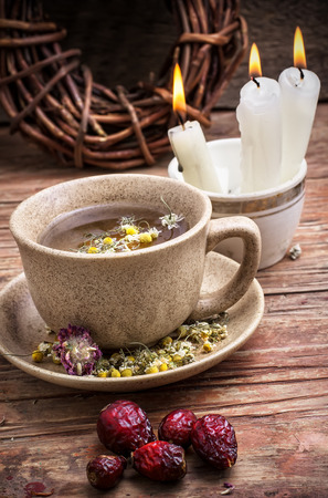 fragrant chamomile tea and briar  in rustic style photo