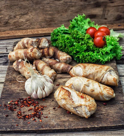 appetising: cooked meat products with spices and tomatoes
