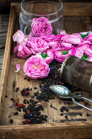 tinted: box with tea accessories herbal tea of roses.The image is tinted Stock Photo