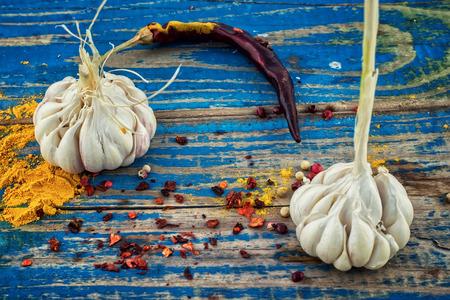 seasoning: garlicpepper and seasoning on wooden vintage background.Selective focus