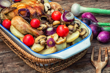 baked whole chicken in vegetables photo