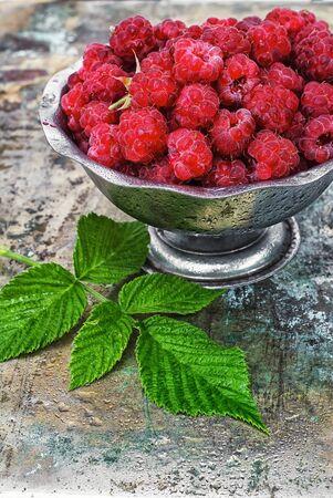 ramekin: Plucked raspberries in vintage iron ramekin.