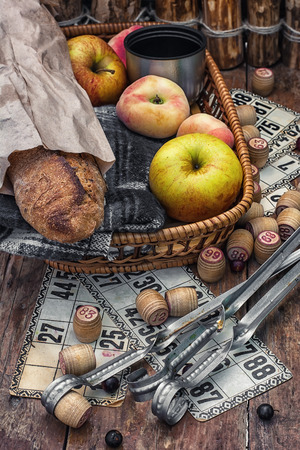 dues: Accessories picnic consisting of peaches, apples and lotto games. Stock Photo