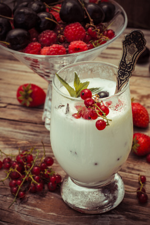 tinted: sweet dessert of ice cream per glass and fresh berries, cherries,currants,strawberries.Photo tinted.