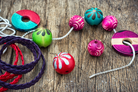 needlework: Wooden beads and accessories for needlework on old wooden  background Stock Photo