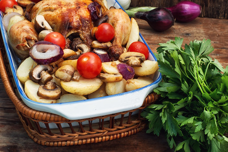 lunch tray: chicken baked to crust in vegetables lined in ceramic form Stock Photo