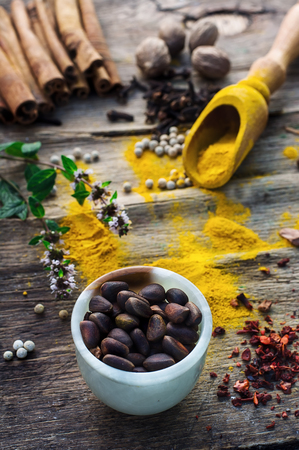 poignant: Set of different spices on the old wooden table.Photo rustic