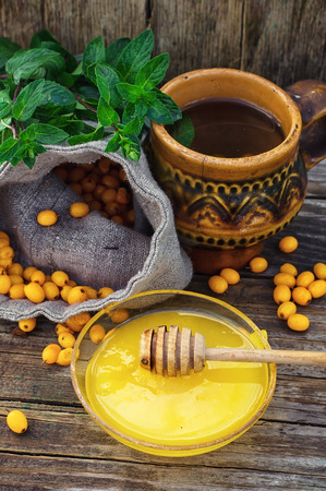 officinal: Clay mug with medicinal decoction of sea buckthorn and honey