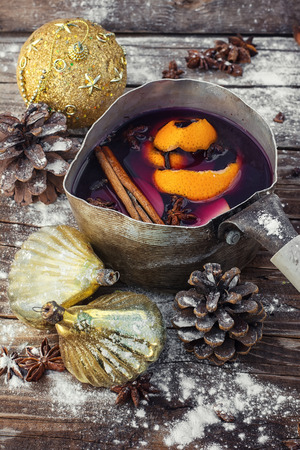 celebration event: The old pot of fragrant mulled wine on the background of Christmas decorations