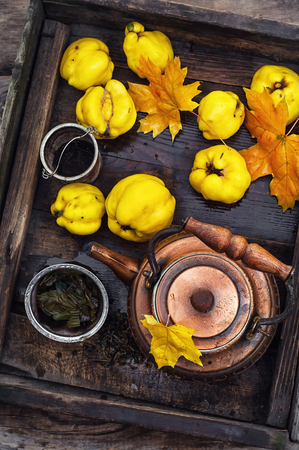 quinces: Copper kettle brewing and quinces in an old stylish derevna box
