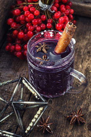mulled wine spice: Crystal goblet with mulled wine and cinnamon stick in it, decorated with star anise Stock Photo