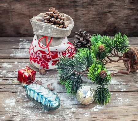 sackful: Vintage pouch with cones on the background of Christmas decoration.