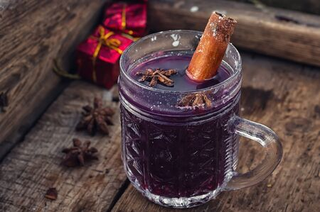 punch spice: glass of hot wine with aromatic spices in stylish wooden box