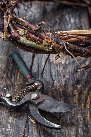 manually: Cut grape branches twisted into crown manually.
