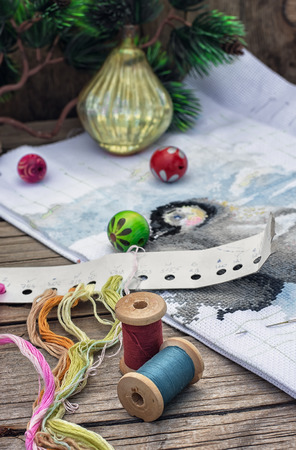 bead embroidery: Spools of thread and beads in Christmas songs in vintage style. Stock Photo