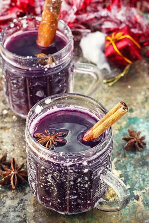 mulled wine spice: Crystal goblet with mulled wine and cinnamon stick in it