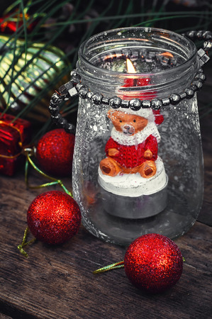 shape cub: Burning Christmas candle in the shape of a bear cub in glass stylish candle holder