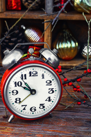 twelve month old: Clock alarm clock with bells on the background of Christmas decorations Stock Photo
