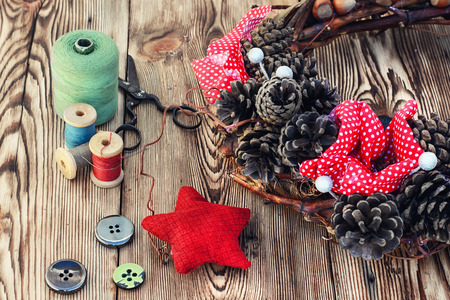 tools of crafts from buttons and thread for the manufacture of Christmas decoration