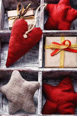 subdivisions: wooden box with subdivisions filled with fabric hearts and stars. Stock Photo