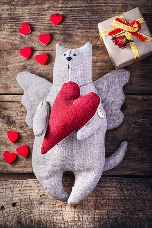 Hand-made,stuffed toy cat with wings.The symbol of Valentines Day