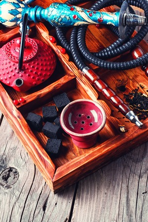 cast iron red: Details of smoking hookah,cast iron red teapot in wooden box