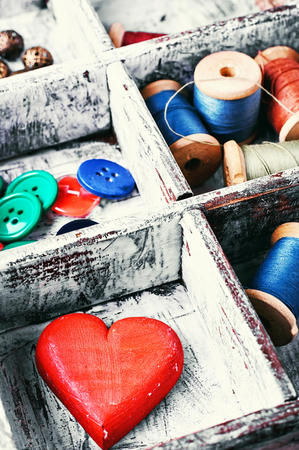 sewing box: Wooden sewing box with threads,buttons and symbolic heart