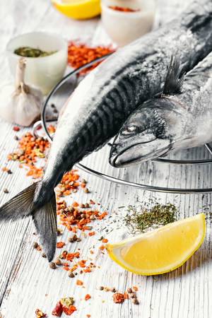 thawed: Thawed fresh fish mackerel with spices and marinade with lemon