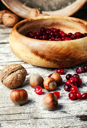 mountain cranberry: And ripe cranberries in a wooden bowl on the kitchen table Stock Photo