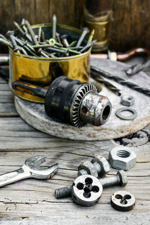 threading: Set of nuts,bolts,springs and dies for threading Stock Photo