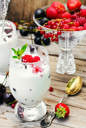 Dairy ice cream with strawberries,currants and raspberries in the glass Stock Photo