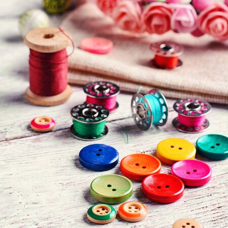 needlework: Buttons of different colors and accessories for needlework Stock Photo