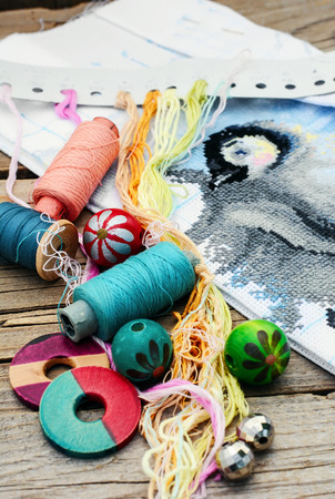 bead embroidery: Set of threads for embroidery on background of handmade paintings