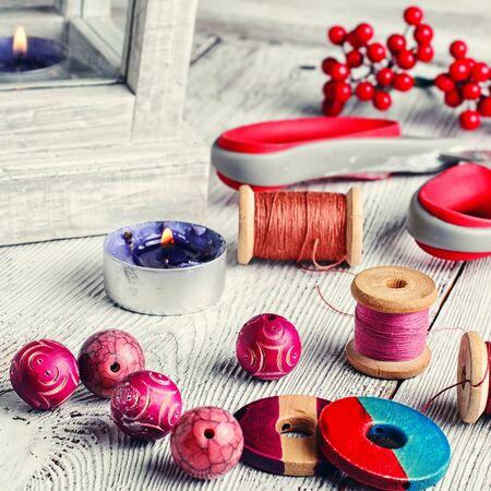 workmanship: Set of bright beads,threads and decorative items for making jewelry Stock Photo