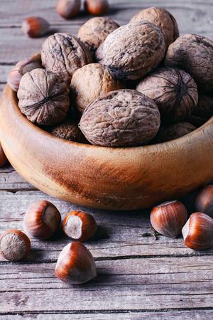 cobnut: Autumn harvest walnuts and hazelnuts on wooden background
