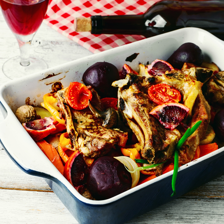 baked meat: Baked meat with vegetables in a red wine Stock Photo