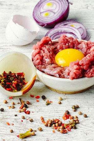 farce: dish with raw minced beef with egg yolk and spice