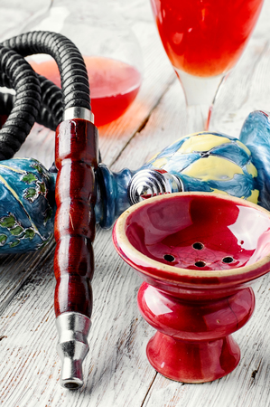 wine  pink: Details smoking Arab hookah and a glass of young wine pink Stock Photo