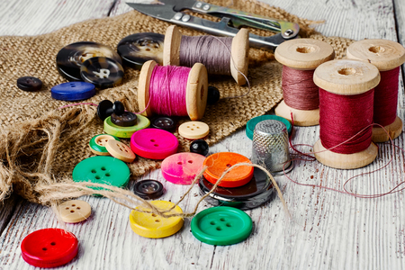 Set of several pied buttons for garment with threads Stock Photo