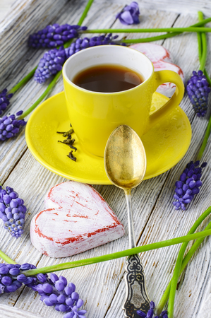 hyacinths: Stylish wooden tray with a mug of tea scattered with fresh hyacinths