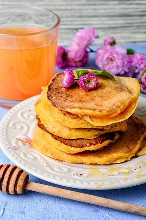 fritter: fritter pancakes with light dishes and glass of juice Stock Photo