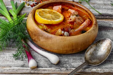 saltwort: Traditional Solyanka with smoked meats in wooden plate