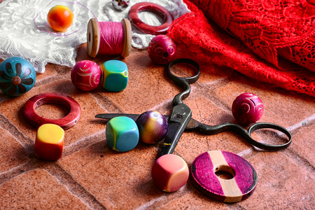 bangles hand: beads on a stone background