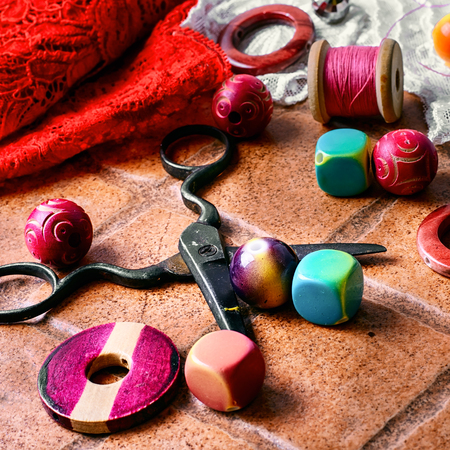 bangles hand: Set for needlework from thread and beads on a stone background Stock Photo