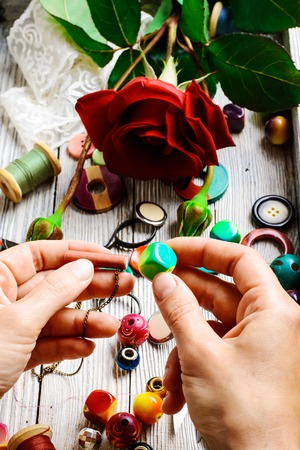 bead embroidery: Hand in the production of jewelry made of beads and decor