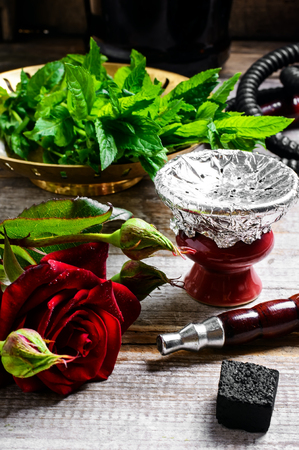 to inhale: Hookah pipe and hookah filled with tobacco with the scent of mint and roses