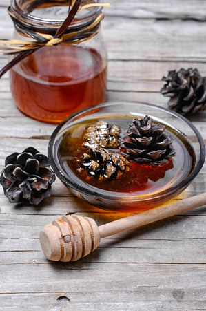 fir cones: Healing jam made from fir cones to help against colds Stock Photo
