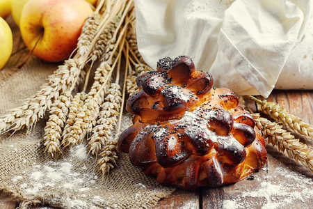 apple sack: Still life with fresh homemade cakes,flour and ears of wheat